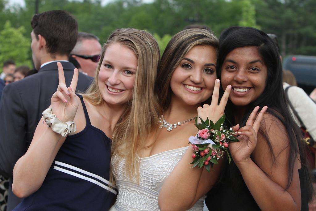 . Tyngsboro High School pre-prom gathering at Tyngsboro Elementary School. From left, Audrey Hall, Molly Breen and Ankita Bhagat. (SUN/Julia Malakie)