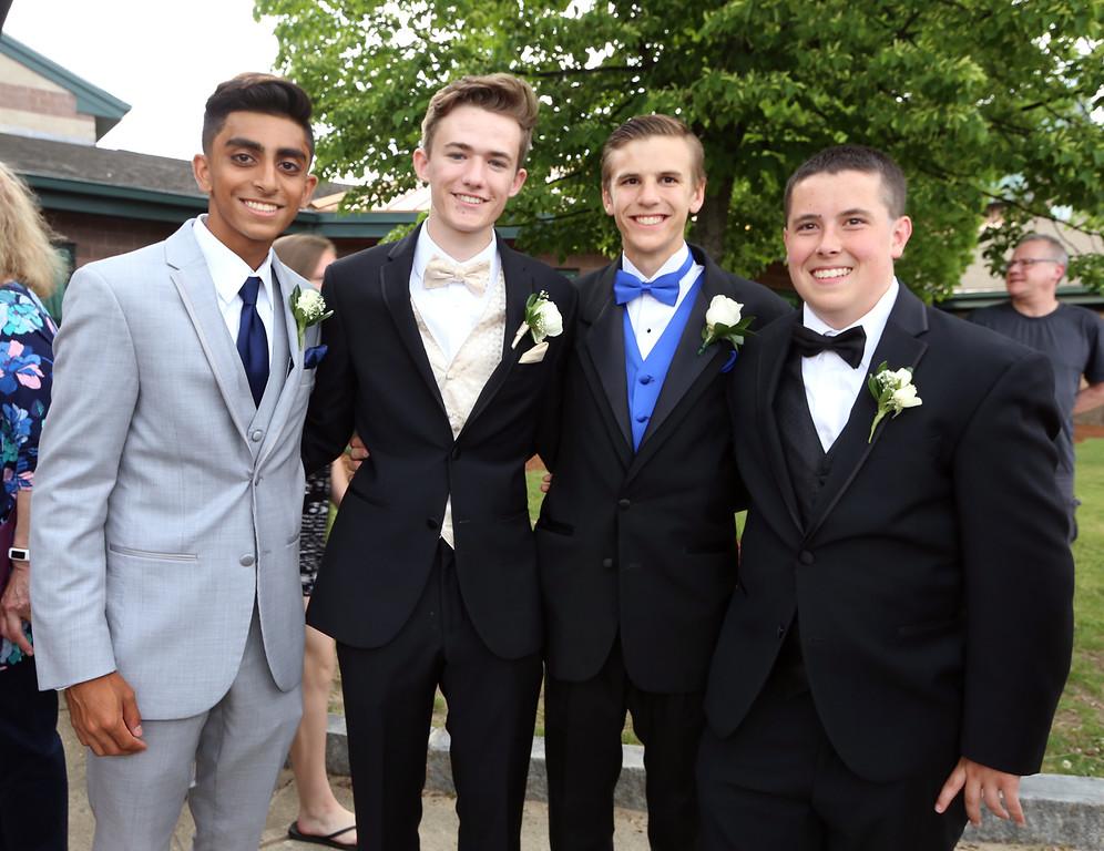 . Tyngsboro High School pre-prom gathering at Tyngsboro Elementary School. From left, Arth Patel, Callum Little, Jacob Carney and Tyler Moulton. (SUN/Julia Malakie)