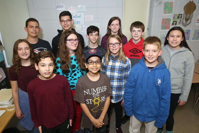 Tyngsboro Knowledge Bowl team. Left to right, front: Ryan Kaminski, 12, Mohammed Aldulaimy, 13, and Campbell Wood, 12. Middle row: Emily Caissie, 12, Madeline Menaker, 13, and Liliane Wood, 12. Rear: Brett Cavanaugh, 15, Nate Marino, 14, Joshua Gauvin, 13, Makayla Hughes, 12, Ryan Graham, 12, and Evianna Young, 12.  (SUN/Julia Malakie)