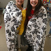 Tyngsboro Middle School students tie together two layers of fleece to make blankets for the homeless. Seventh graders Brooke Cavanaugh, left, and Kendall Times, both 13 and from Tyngsboro. (SUN/Julia Malakie)