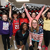 Tyngsboro Middle School students tie together two layers of fleece to make blankets for the homeless. Clockwise from left rear: sixth graders Sedona Feddersen, 11, Anna Poulios, 11, Jenna Trischitta, 12, Trinidi Silva, 12, Maggie Casey, 12, Lilian Wood, 12, and Dahlya Zoua, 12. All are from Tyngsboro except Silva from Dunstable. (SUN/Julia Malakie)