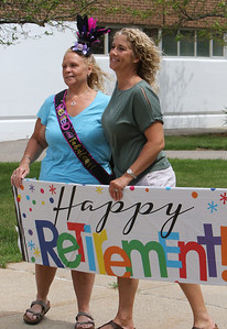Parade for retiring Tyngsboro Middle School teacher Karen Gagnon, in front of the school. Gagnon, left, and ELA teacher Suzanne Dick of Seabrook. (SUN/Julia Malakie)