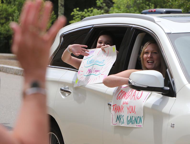 Parade for retiring Tyngsboro Middle School teacher Karen Gagnon, in front of the school. [Missed these names] (SUN/Julia Malakie)