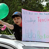 "Parade for retiring Tyngsboro Middle School teacher Karen Gagnon, in front of the school. Sixth grader Anthone Drillo hands a balloon to Gagnon. His sign says ""Goodbye Tension, Hello Pension."" (SUN/Julia Malakie)"