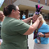Parade for retiring Tyngsboro Middle School teacher Karen Gagnon, in front of the school. Science teacher Tilli Andrews-Wojtczak of Westford gives Gagnon her crown. At left is ELA teacher Suzanne Dick of Seabrook, N.H.  (SUN/Julia Malakie)