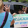 Parade for retiring Tyngsboro Middle School teacher Karen Gagnon, in front of the school. Gagnon waves at 6th grader Zach Kaminski, 11, and his mother Lisa Kaminski. (SUN/Julia Malakie)