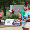 Parade for retiring Tyngsboro Middle School teacher Karen Gagnon, in front of the school. Gagnon waves at passing cars. (SUN/Julia Malakie)