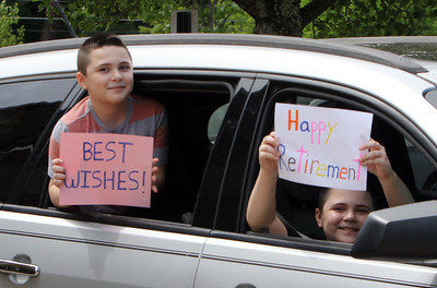 Parade for retiring Tyngsboro Middle School teacher Karen Gagnon, in front of the school. Twins Ethan, left, and Dominic Trottier, 12, hold up their signs.  (SUN/Julia Malakie)