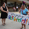 Parade for retiring Tyngsboro Middle School teacher Karen Gagnon, in front of the school. Math teacher April Eringis of Lowell, left, looks on as Gagnon wipes her eyes after the surprise. Gagnon was told it was going to be a parade for the kids.  (SUN/Julia Malakie)