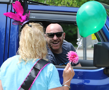 Parade for retiring Tyngsboro Middle School teacher Karen Gagnon, in front of the school.  Gagnon chats with TMHS principal Jeff Ogden. (SUN/Julia Malakie)