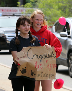 Parade for retiring Tyngsboro Middle School teacher Karen Gagnon, in front of the school. Anna Poulios, 12, left, and Anna Barton, 13, who had Gagnon for a teacher in 6th grade, bring her their sign. (SUN/Julia Malakie)