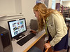 Bob Raines--Montgomery Media<br /> Lucile Ionescu scrolls through a catalogue of pre-programmed shapes for a 3-D printer at the Upper Dublin Public Library May 27, 2015. She is one of six high school seniors in the library's STEAM project.