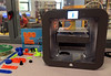 Bob Raines--Montgomery Media / <br /> The STEAM Lab 3-D printer churns out Benjamin Franklin, while to the left are some of the items the Upper Dublin students in the program have made May 27, 2015.