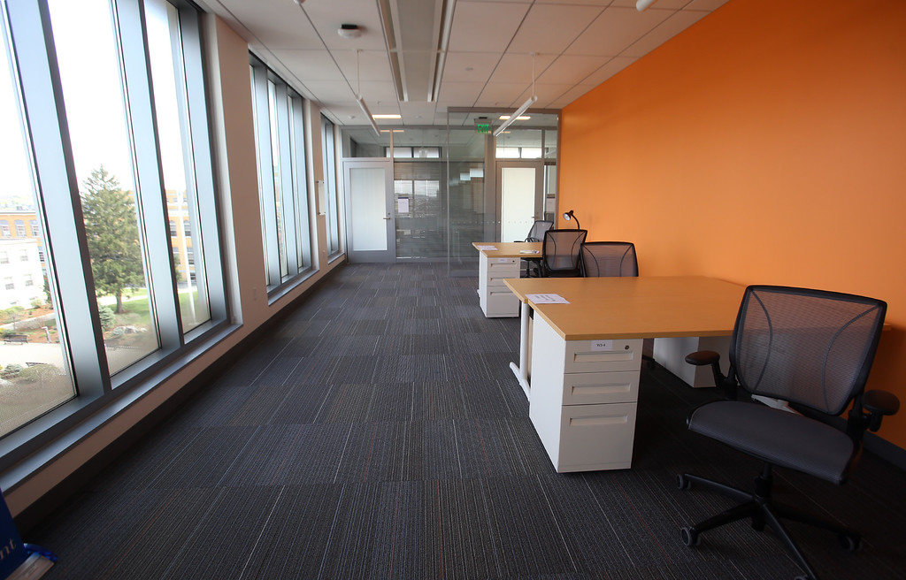 . PhD student space at the Pulichino Tong Business Center, new home of the Manning School of Business at UMass Lowell. The doctoral students will have their own desks, and some dividers will be added. (SUN/Julia Malakie)