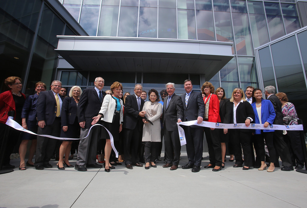 . Ribbon cutting ceremony for the Pulichino Tong Business Center, new home of the Manning School of Business at UMass Lowell. From left, DCAMM commissioner Carol Gladstone, UML senior vice chancellor Joanne Yestramski, major donors Jerry and Joyce Colella, for whom the Colella Atrium inside is named, Prof. Emeritus Stuart Mandell, chancellor Jacquie Moloney, major donors Joy Tong and husband John Pulichino, for whom building is named, UMass president Marty Meehan, State Rep. Dave Nangle, former Manning School dean Kathy Carter (now senior advisor to the provost), current dean Sandra Richtermeyer, trustee Mary Burns, and Student Trustee Malinda Reed of Lowell.
