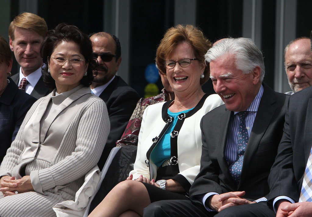 . Front from left, donor Joy Tong, chancellor Jacquie Moloney, and UMass president Marty Meehan. (SUN/Julia Malakie)