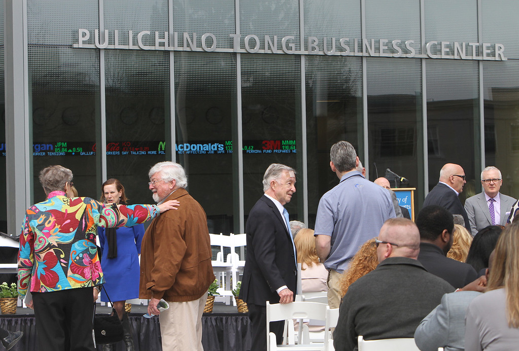 . Guests awaiting ribbon cutting ceremony for the Pulichino Tong Business Center, new home of the Manning School of Business at UMass Lowell. (SUN/Julia Malakie)
