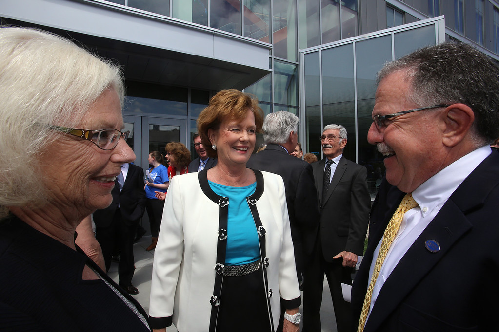 . Ribbon cutting ceremony for the Pulichino Tong Business Center, new home of the Manning School of Business at UMass Lowell. Chancellor Jacquie Moloney, center, talks to Joyce Colella \'77 and husbandf Jerry Colella \'78 of Seabrook Beach, N.H. and Naples, Florida, donors for whom the Colella Atrium is named. (SUN/Julia Malakie)