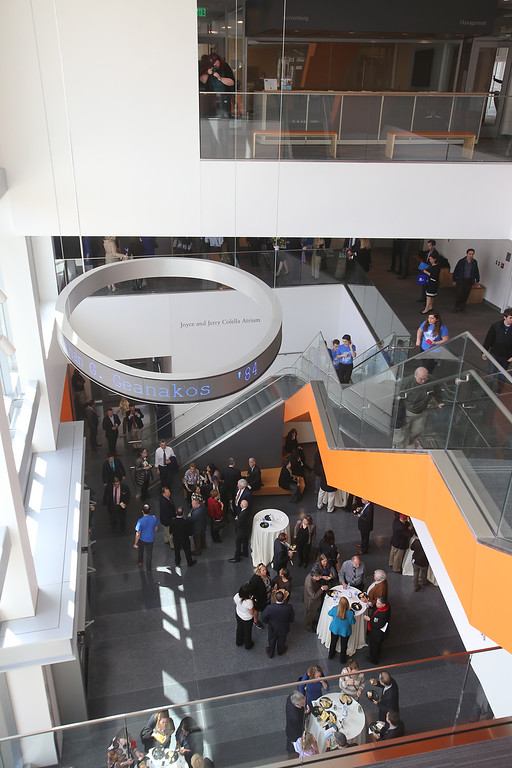 . View of Colella Atrium from the second floor at the Pulichino Tong Business Center, new home of the Manning School of Business at UMass Lowell. This shade of orange was chosen from many shades of orange, according to one speaker. (SUN/Julia Malakie)