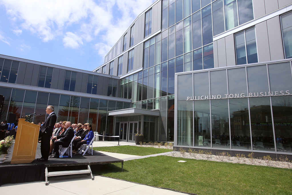 . John Pulichino speaks at the ribbon cutting ceremony for the Pulichino Tong Business Center, new home of the Manning School of Business at UMass Lowell. (SUN/Julia Malakie)