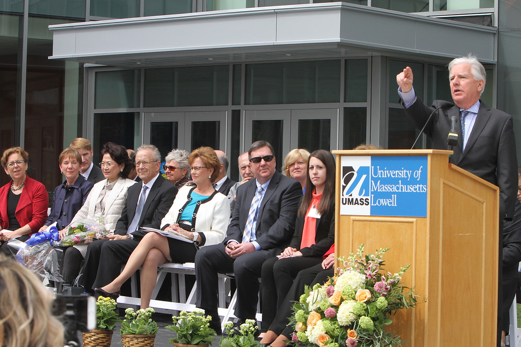 . UMass president Marty Meehan speaks at ribbon cutting ceremony for the Pulichino Tong Business Center, new home of the Manning School of Business at UMass Lowell. Listening, from left, DCAMM commissioner Carol Gladstone, senior vice chancellor Joanne Yestramski, donors Joy Tong and husband John Pulichino, chancellor Jacquie Moloney, State Rep. Dave Nangle, and student speaker Rebecca Foley \'18. (SUN/Julia Malakie)