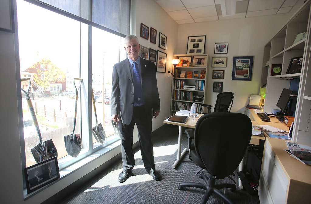 . Jack Wilson, President Emeritus and Distinguished Professor, has his office in the Pulichino Tong Business Center, new home of the Manning School of Business at UMass Lowell. (SUN/Julia Malakie)