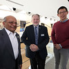 From left, Ashwin Mehta, associate teaching professor at the Manning School of Business and program director for the Global Entrepreneurship Exchange, vice provost Steve Tello, and doctoral student in biochemistry Fang Zhang, originally from China. UMass Lowell is working to incrase its international program. (SUN/Julia Malakie)