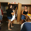 Moving-in day at UMass Lowell. Roommates Courtney Heath of Torrance, California, center, and Meghan Spence of Dracut, right, unpack their clothes as Spence's parents Jeff and Amy Spence look on. (SUN/Julia Malakie)