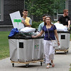 Moving-in day at UMass Lowell. Jason Lazera of Bridgewater, left, moves his stuff into University Suites with help from his parents Al and Dulce Lazera. (SUN/Julia Malakie)