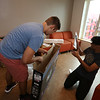 "Moving-in day at UMass Lowell. Roommates Aum Trivedi of Andover, right, and Oliver Carlson of Concord, set up a 43"" TV Trivedi brought for their suite. (SUN/Julia Malakie)"
