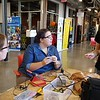 UMass Lowell, with Society of Women Engineers,  holds a Repair Cafe to do free repairs, in the Lawrence Lin Makerspace in Falmouth Hall. Freshman Katey Bonitatibus, from Reading, left, and junior Veronica Brown of Dracut, work on resoldering an Android charger. (SUN/Julia Malakie)