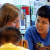 "Alan Martinez, right, talks to teacher Erin Harrington in class on Wdnesday.<br /> All of the 3rd-graders at University Hill Elementary  who took the English version of the TCAP test scored proficient or advanced.<br /> Sunday. For more photos of 3rd-graders at Uni-Hill, go to  <a href=""http://www.dailycamera.com"">http://www.dailycamera.com</a>.<br /> Cliff Grassmick / May 9, 2012"