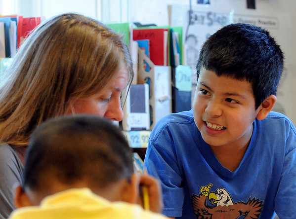 """Alan Martinez, right, talks to teacher Erin Harrington in class on Wdnesday.<br /> All of the 3rd-graders at University Hill Elementary  who took the English version of the TCAP test scored proficient or advanced.<br /> Sunday. For more photos of 3rd-graders at Uni-Hill, go to  <a href=""""http://www.dailycamera.com"""">http://www.dailycamera.com</a>.<br /> Cliff Grassmick / May 9, 2012"""