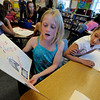 "Sophia Wendell, left, reads to Jenna Gaudette and other 3rd-grade classmates on Wednesday.All of the 3rd-graders at University Hill Elementary  who took the English version of the TCAP test scored proficient or advanced.<br /> Sunday. For more photos of 3rd-graders at Uni-Hill, go to  <a href=""http://www.dailycamera.com"">http://www.dailycamera.com</a>.<br /> Cliff Grassmick / May 9, 2012"