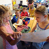 "Ruth Holcomb, left, and Lola D'Onofrio, read their poster to Zig Lewon, Preston Daley and Jaden Tillman during class on Wednesday.<br /> All of the 3rd-graders at University Hill Elementary  who took the English version of the TCAP test scored proficient or advanced.<br /> Sunday. For more photos of 3rd-graders at Uni-Hill, go to  <a href=""http://www.dailycamera.com"">http://www.dailycamera.com</a>.<br /> Cliff Grassmick / May 9, 2012"
