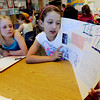 "Sophia Wendell, left, listens to Jenna Gaudette read her project on the trachea in class on Wednesday.<br /> All of the 3rd-graders at University Hill Elementary  who took the English version of the TCAP test scored proficient or advanced.<br /> Sunday. For more photos of 3rd-graders at Uni-Hill, go to  <a href=""http://www.dailycamera.com"">http://www.dailycamera.com</a>.<br /> Cliff Grassmick / May 9, 2012"