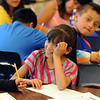 "Daisy Ordaz smiles at her classmate during class on Wednesday.<br /> All of the 3rd-graders at University Hill Elementary  who took the English version of the TCAP test scored proficient or advanced.<br /> Sunday. For more photos of 3rd-graders at Uni-Hill, go to  <a href=""http://www.dailycamera.com"">http://www.dailycamera.com</a>.<br /> Cliff Grassmick / May 9, 2012"