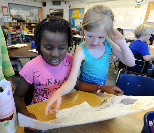 "Lerato Osnes, left,  and Finelle Guy, read over their poster project in literacy class on Wednesday.<br /> All of the 3rd-graders at University Hill Elementary  who took the English version of the TCAP test scored proficient or advanded.<br /> Sunday. For more photos of 3rd-graders at Uni-Hill, go to  <a href=""http://www.dailycamera.com"">http://www.dailycamera.com</a>.<br /> Cliff Grassmick / May 9, 2012"