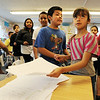 "Alan Martinez, left, and Daisy Ordaz, hand in their literacy work on Wednesday.<br /> All of the 3rd-graders at University Hill Elementary  who took the English version of the TCAP test scored proficient or advanced.<br /> Sunday. For more photos of 3rd-graders at Uni-Hill, go to  <a href=""http://www.dailycamera.com"">http://www.dailycamera.com</a>.<br /> Cliff Grassmick / May 9, 2012"