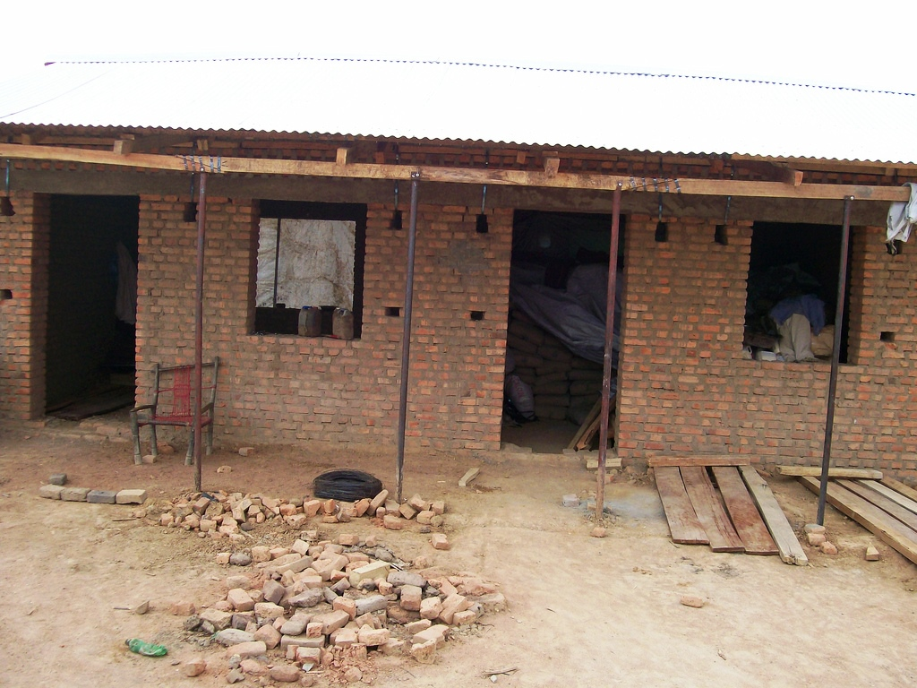 The teachers' office. Note the bags of cement stored on the right-hand side. The rainy season has some dry, sunny days, and our cement is waiting safely for work to continue on those days.