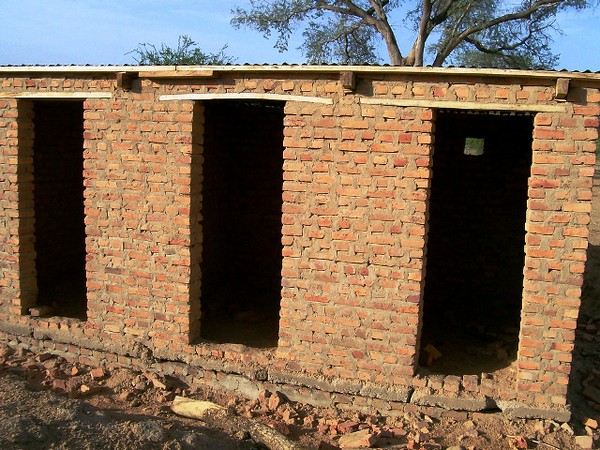 With our three latrines -- one for boys, one for girls, and one for teachers -- we elevate the santitation level of the school and qualify for partnership with large, international NGOs.