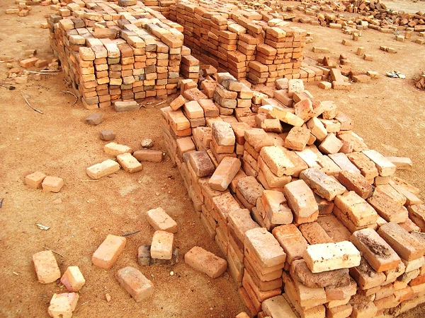 The bricks were moved from the kiln to the construction site by hand.