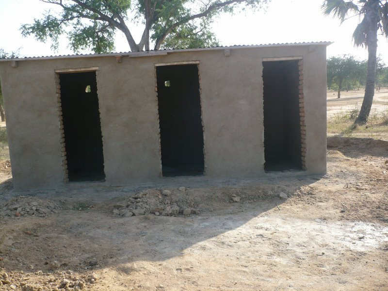 Our latrines have received a coating of stucco.