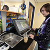 Students and teachers at Valley Collaborative's middle and high school, and adult over-22 program. Cody Sweeney, 17, of Lexington, using Photoshop in the STEM classroom. (SUN/Julia Malakie)