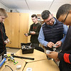 Students and teachers at Valley Collaborative's middle and high school, and adult over-22 program. From left, Kevin Surette, 14, of Ayer, John Haynes, 17, of Chelmsford, assistant principal Glen Costello of Litchfield, and Corey Thompson, 16, of Leominster, making robots in the STEM classroom.  (SUN/Julia Malakie)