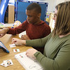 Students and teachers at Valley Collaborative's middle and high school, and adult over-22 program. Devin Shompole, 16, of Lowell, working with speech therapist Abbie King of Chelmsford, using a NOVAchat device, in the ASD ISN classroom (autism spectrum disorder intensive special needs) where students get one on one instruction. (SUN/Julia Malakie)