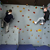 Students and teachers at Valley Collaborative's middle and high school, and adult over-22 program. Middle school students Aidan Macdonald, 14, of Tewksbury, left, and Adam Conant, 13, of Dracut, on the climbing wall.  (SUN/Julia Malakie)