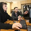 Students and teachers at Valley Collaborative's middle and high school, and adult over-22 program. Luis Algarin, 16, of Billerica, left, doing coding for a program to turn on an LCD screen on a device, with science teacher Corey Shepherd of Methuen, in the STEM classroom. (SUN/Julia Malakie)
