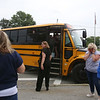 Seeing off the buses after the last day of school at Vining Elementary School before it closes. (SUN/Julia Malakie)