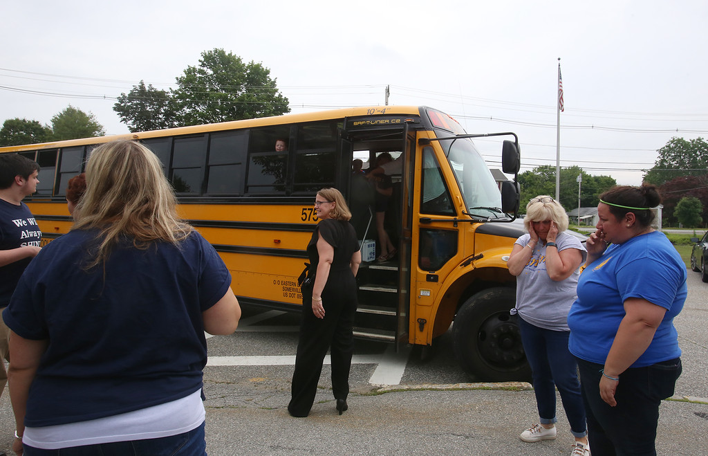 . Seeing off the buses after the last day of school at Vining Elementary School before it closes. (SUN/Julia Malakie)